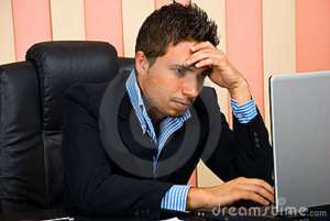 stressed-businessman-browsing-internet-14730384