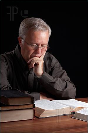 Man-Reading-Bible-2011512
