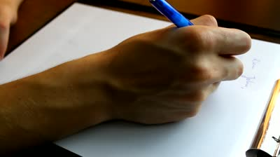 stock-footage-close-up-of-a-hand-writing-a-letter